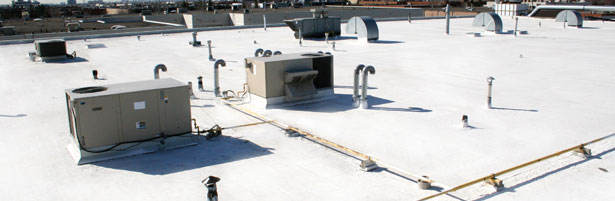 Apartment Building Roof fuel ghoul: tiocoat white roof solution helps green builders show