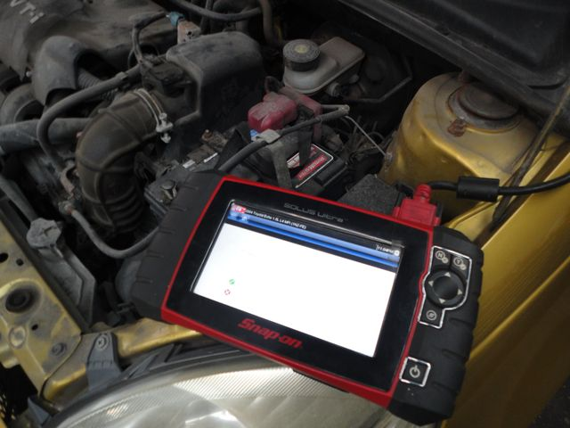 Sensor at car engine emission test
