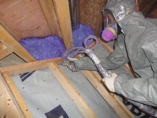 spray foam insulation application expert on job site